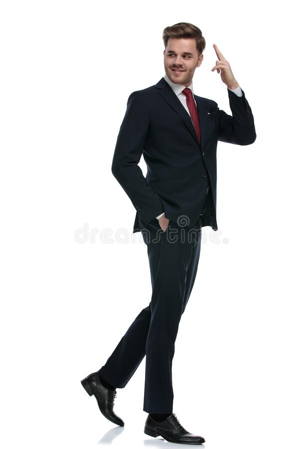 Glad ung affärsman som leker och har en militär hälsning royaltyfria bilder