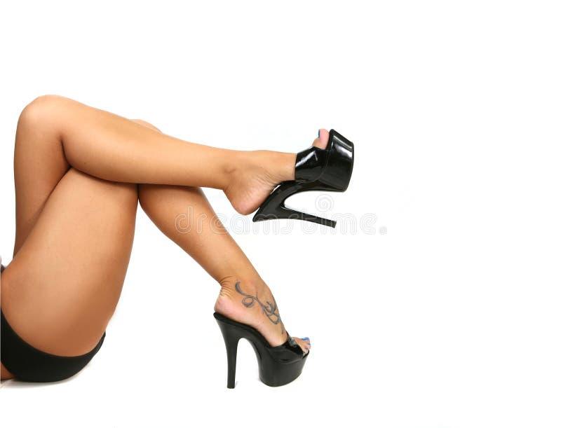 Gladde Sexy Benen met Zwarte stock foto