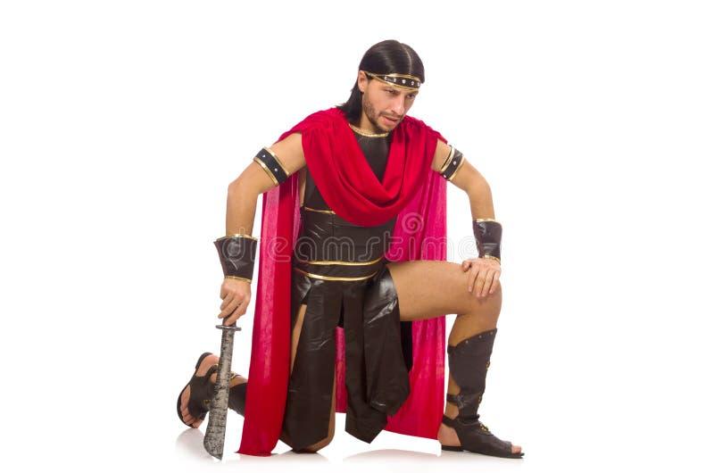 Gladiador que sostiene la espada aislada en blanco imagen de archivo