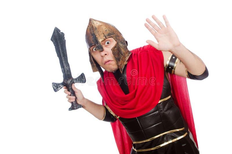 Gladiador que sostiene la espada aislada en el blanco foto de archivo