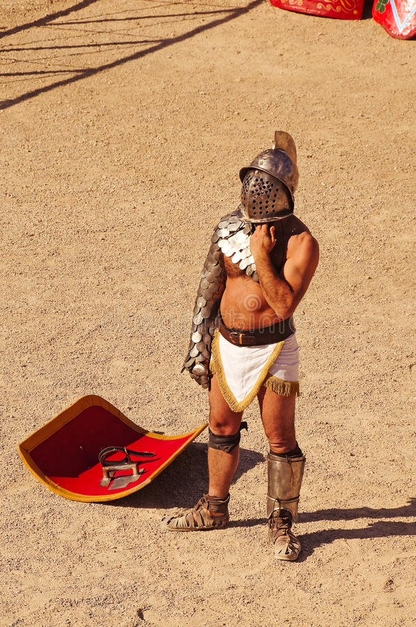 Gladiator. A gladiator on the arena of an amphitheater in tarragona,spain stock images