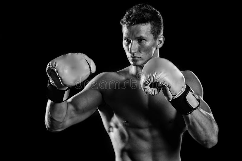Gladiator or atlant in boxing gloves. Sport and workout. Athletic bodybuilder pose in pants. Man with muscular body. Boxer with bare chest, black and white stock images