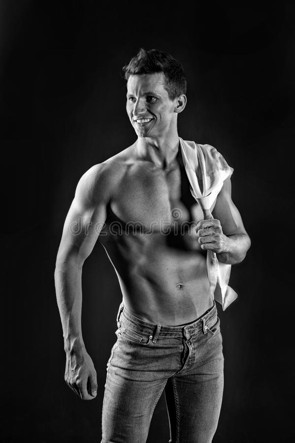 Gladiator or atlant. Guy with bare chest in jeans and shirt. Athletic bodybuilder pose. Sport and workout. Man with muscular body stock photos