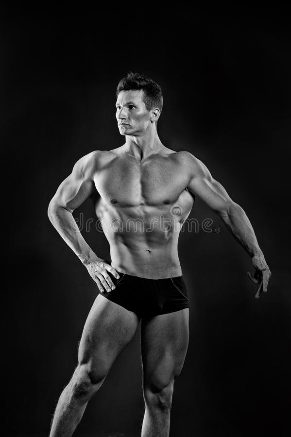 Gladiator or atlant. Sport and workout. Adam with bare chest. Athletic bodybuilder pose in pants. Man with muscular body, black and white royalty free stock photos