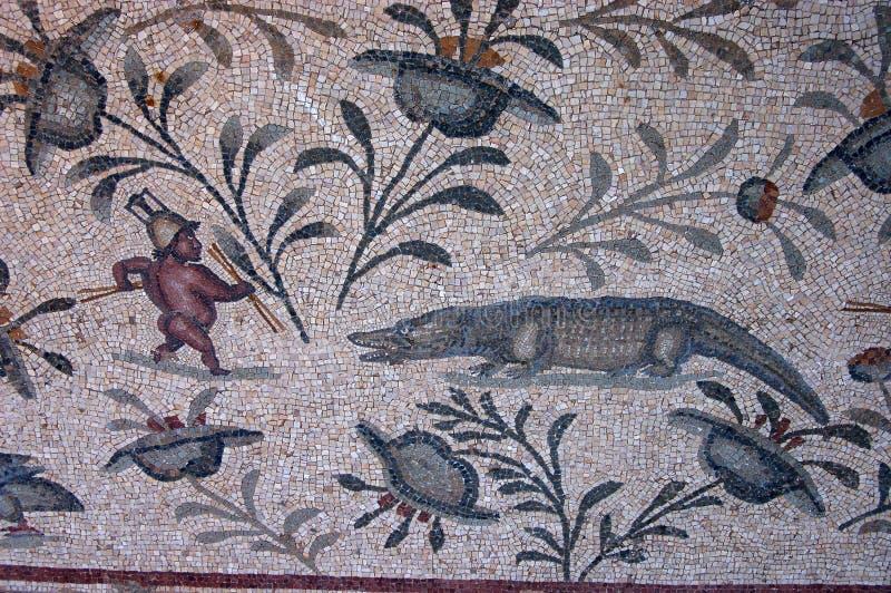 Gladiator and crocodile mosaic stock photography