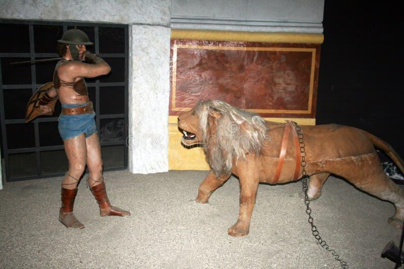 Gladiator en leeuw royalty-vrije stock fotografie