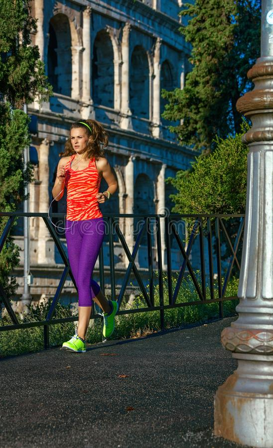 Young fitness woman in sport clothes in Rome, Italy running. Gladiator inspiring trainings. young fitness woman in sport clothes in Rome, Italy running royalty free stock photography