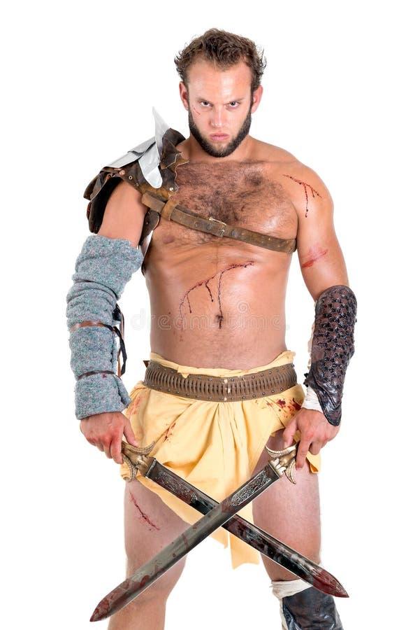 Gladiator, wojownik odizolowywający w bielu/ zdjęcia stock