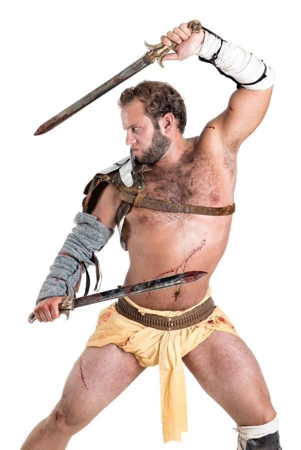 Gladiator, wojownik odizolowywający w bielu/ obraz royalty free