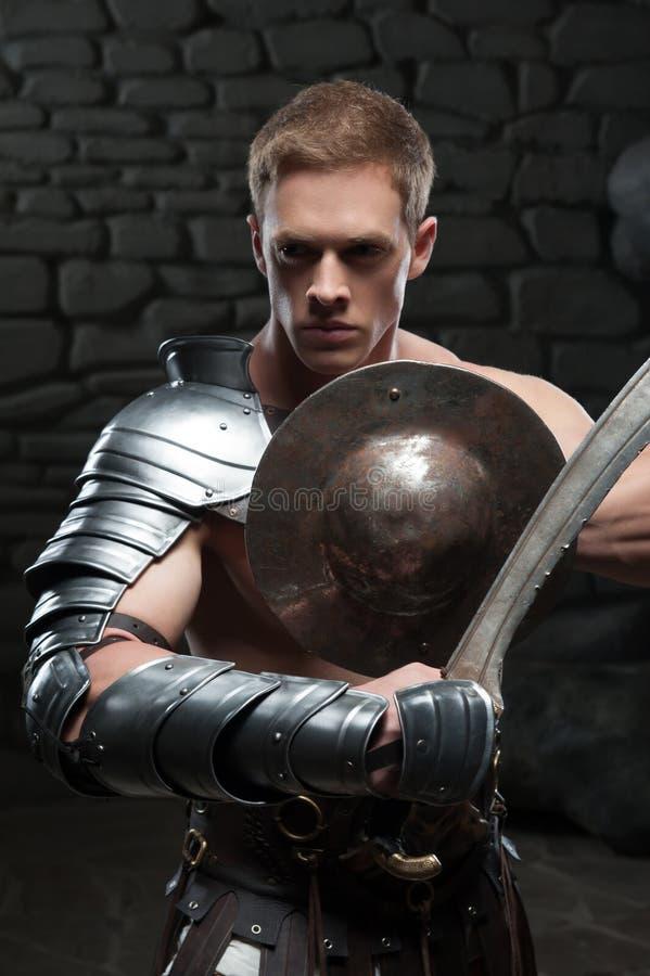 Gladiator z osłoną i kordzikiem fotografia royalty free