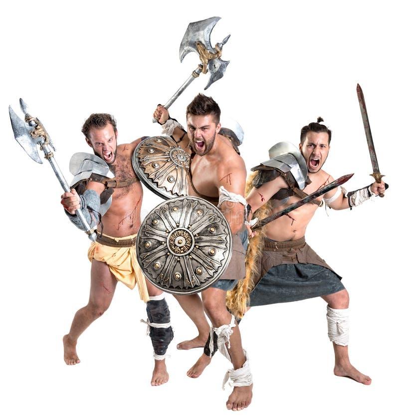 Gladiatori/guerrieri barbari immagine stock