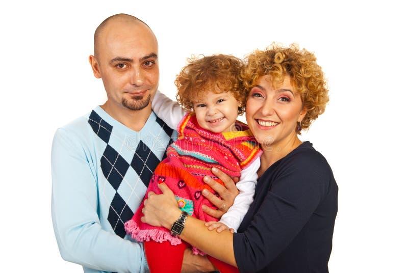 Gladlynt familj med dottern arkivbild