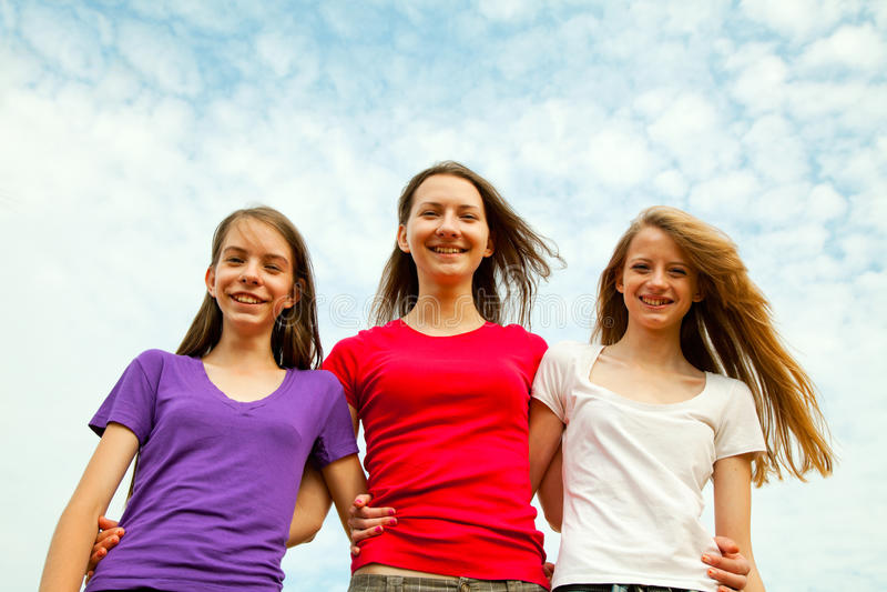 gladlynt flickor teen tre fotografering för bildbyråer