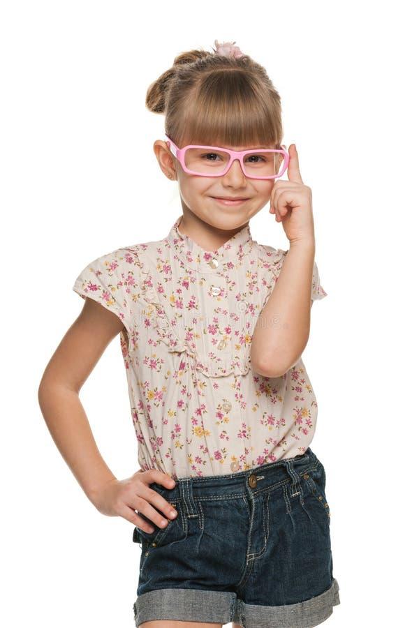 Gladlynt liten flicka i exponeringsglas fotografering för bildbyråer