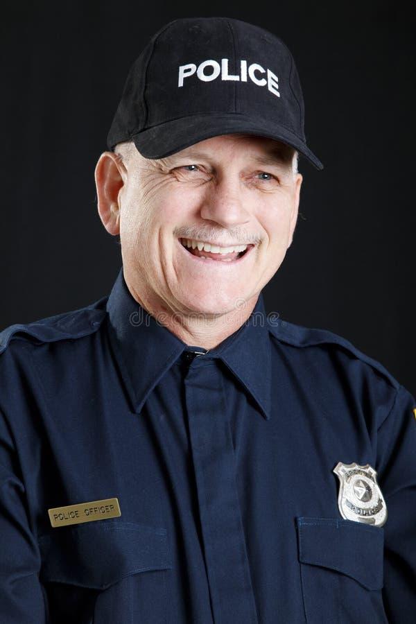 gladlynt polis fotografering för bildbyråer
