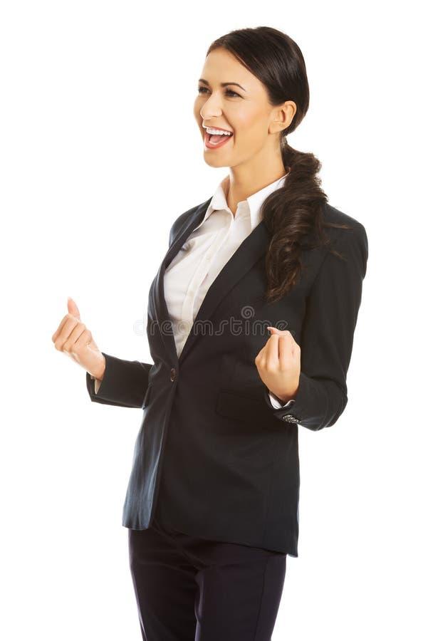 gladlynt stående för affärskvinna arkivbild