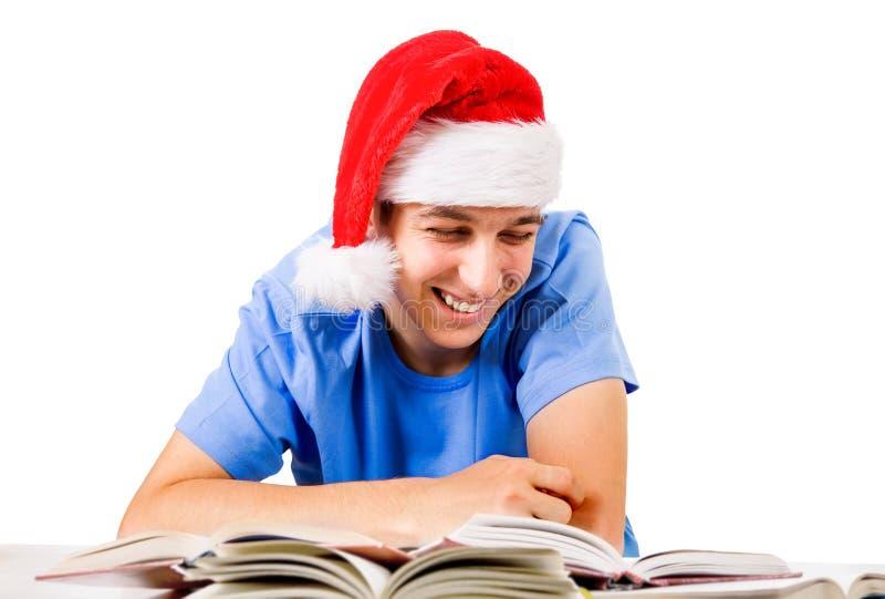 Gladlynt student i Santa Hat royaltyfri foto