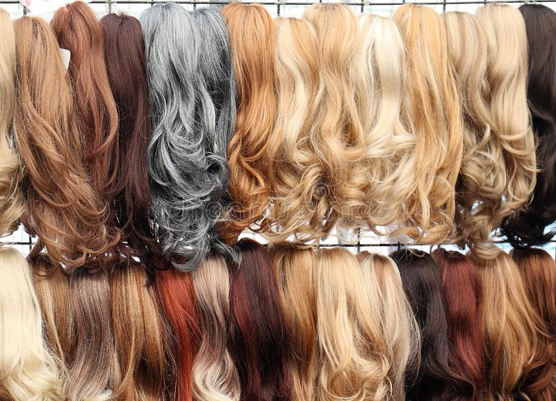 Glam hair extensions. Glam female hair extensions in different colors and styles royalty free stock photo