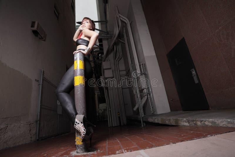 Glam Punk Rocker at night. Edgy punk glam rocker in the city stock image