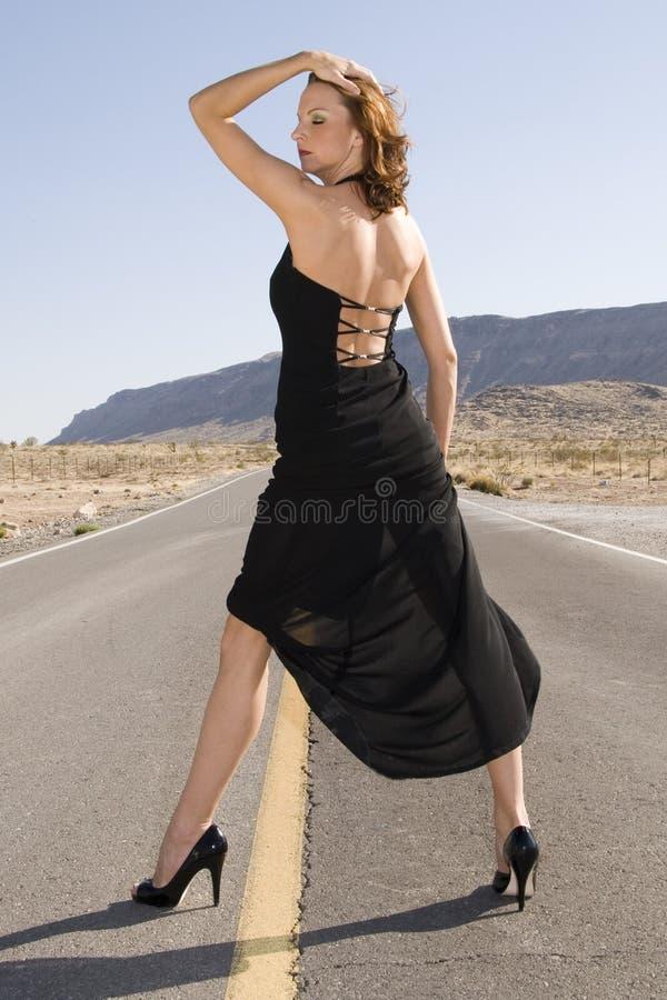 glamorös svart klänning royaltyfria foton