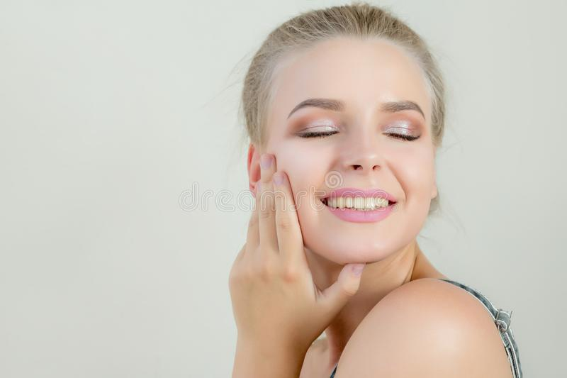 Glamor blonde model with perfect makeup and closed eyes posing o stock image