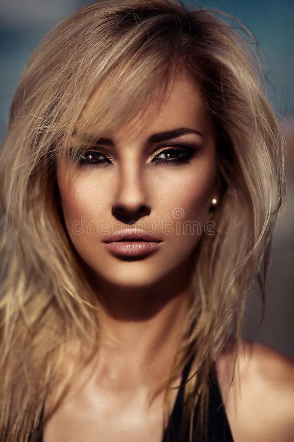Glamor closeup portrait of beautiful stylish blond Caucasian young woman model with bright makeup, with perfect sunbathed royalty free stock images