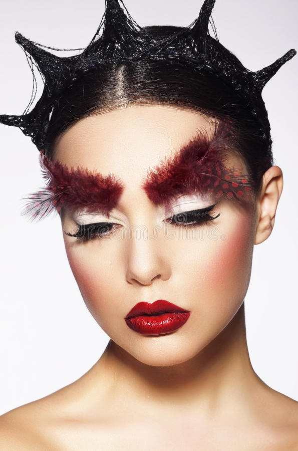 Glamor. Eccentric Woman with Surreal Theatrical Hairdress stock images
