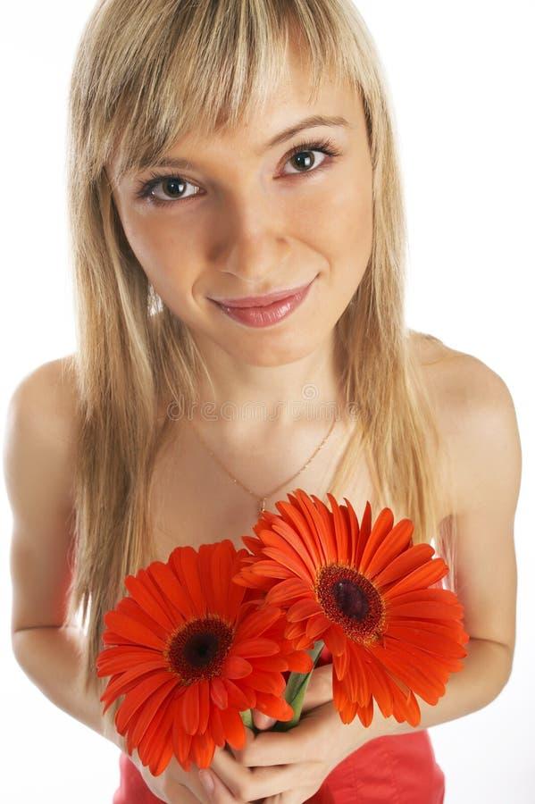 Glamor girl in a orange dress royalty free stock image