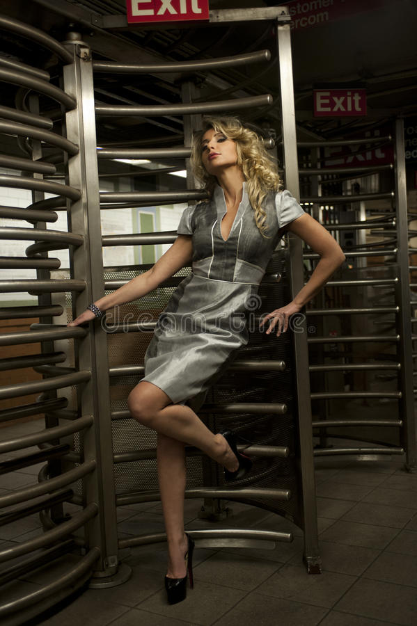 Download Glamor Model Standing By Entrance With Revolving Door To Subway Stock Photo - Image: 36371988
