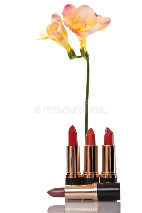 Glamor red shiny lipstick and yellow flower stock photos