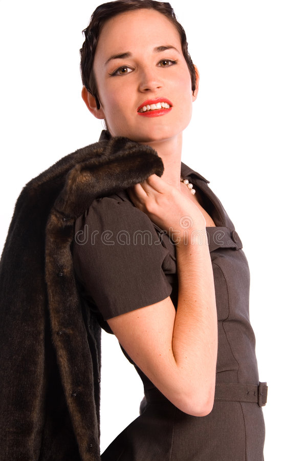 Glamorous 1920s woman. Portrait of a glamorous 1920s style woman holding a fur coat over her shoulder. Isolated on white stock images