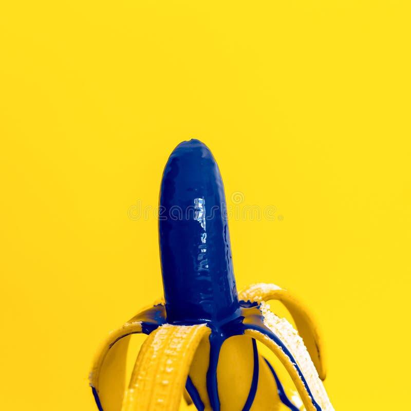 Glamorous Banana With Blue Paint On Yellow Background ... - photo#20