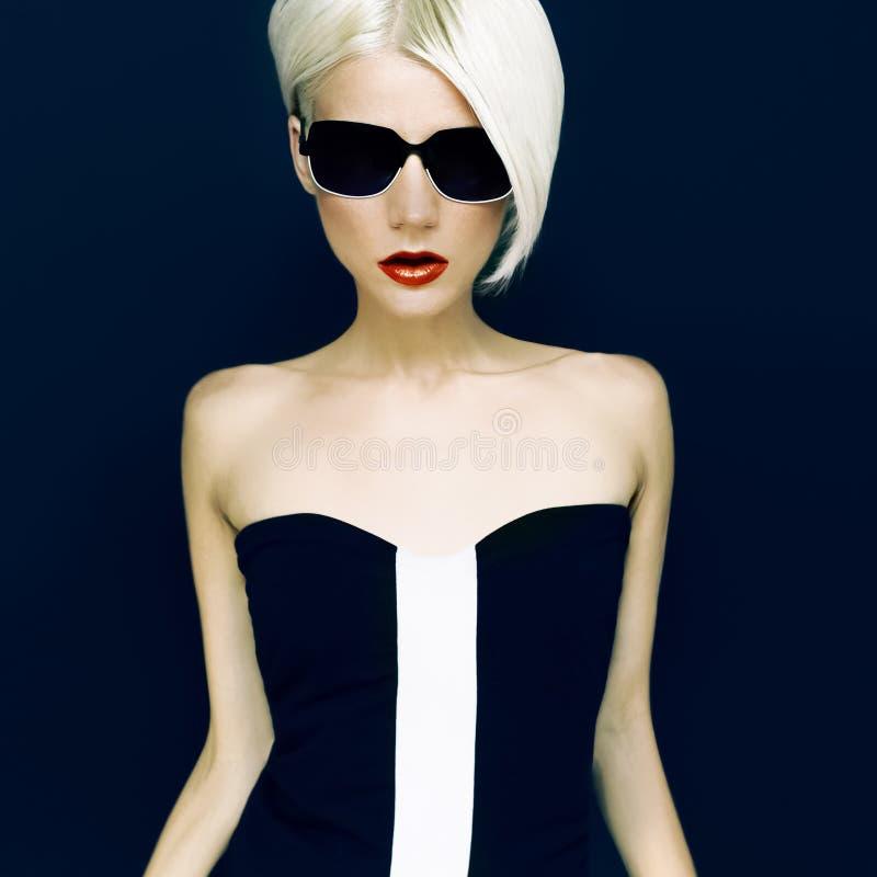 Glamorous Blonde on Black background. Fashion Style stock image