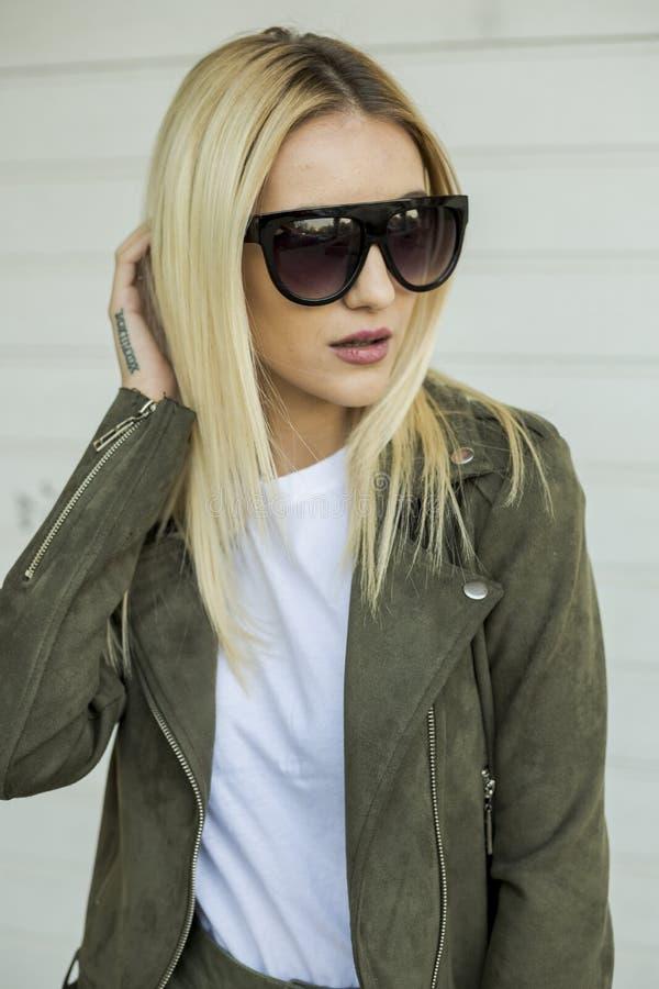 Glamorous blonde on the street. urban fashion. Close up royalty free stock image