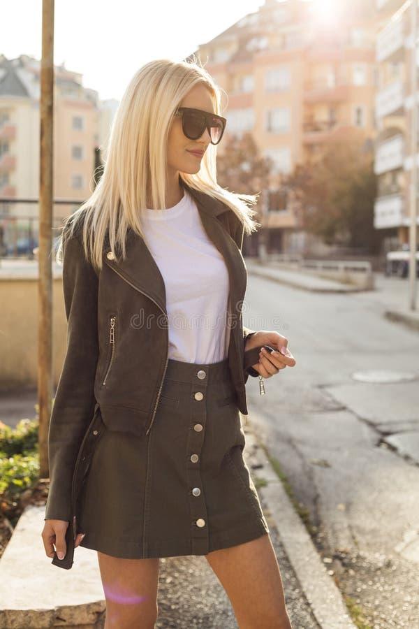 Glamorous blonde on the street. urban fashion. Close up stock image