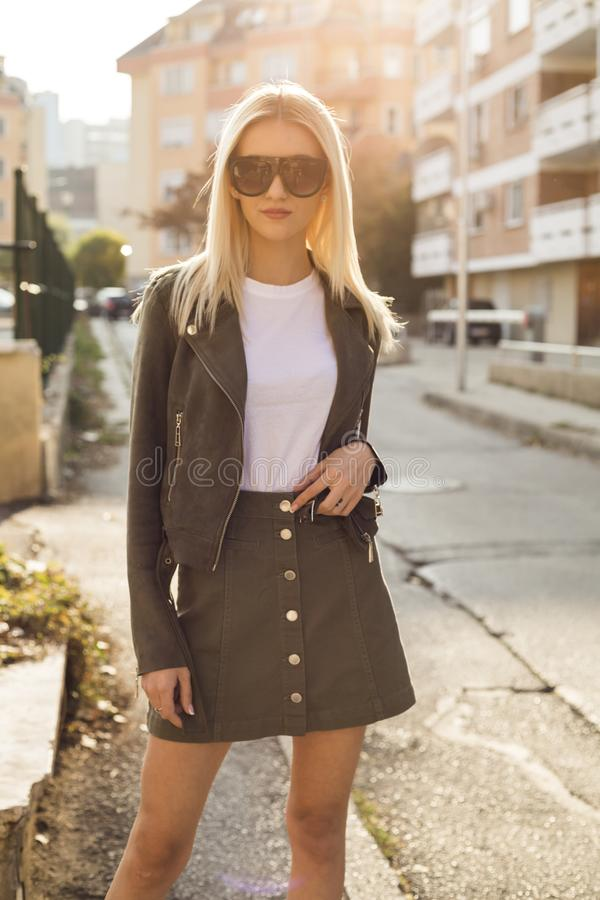 Glamorous blonde on the street. urban fashion. Close up royalty free stock photography