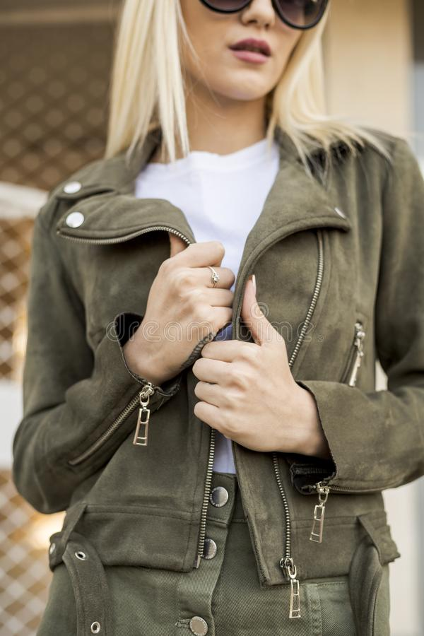 Glamorous blonde on the street. urban fashion. Close up royalty free stock images