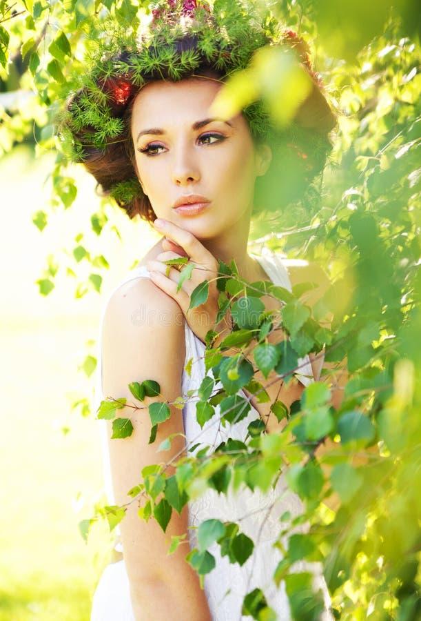 Glamorous brunette lady among greenery stock images