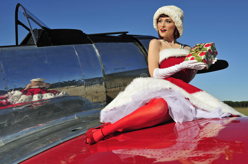 Glamorous Christmas pin up girl royalty free stock image