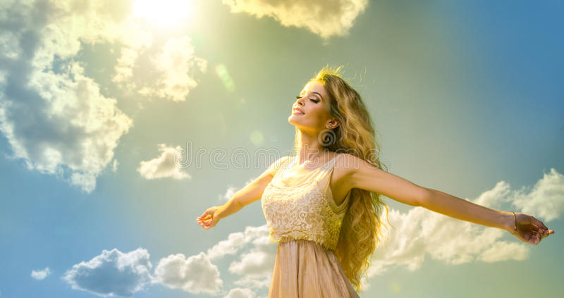 Glamorous curvy blonde woman. Free Happy Woman in clouds stock photo