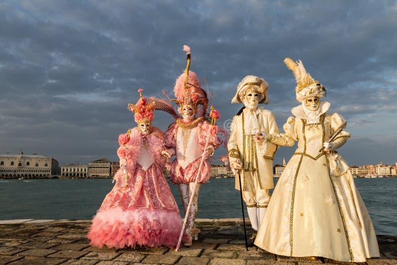 Glamorous, elegant and stylish aristocrat performer during venice carnival. Glamorous, elegant and stylish aristocrat models with pink and gold costume during stock images