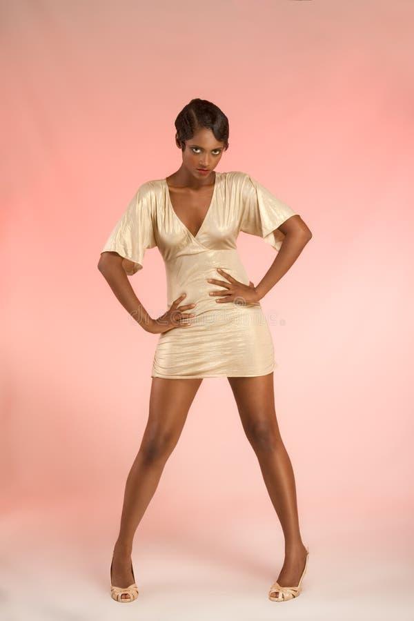 Glamorous ethnic woman in flirting pose royalty free stock photos