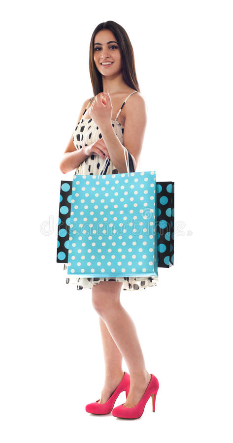 Glamorous Female Carrying Shopping Bags Royalty Free Stock Image