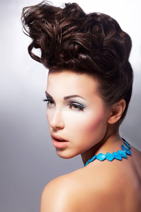 Glamorous female. Luxury coiffure and make up royalty free stock image