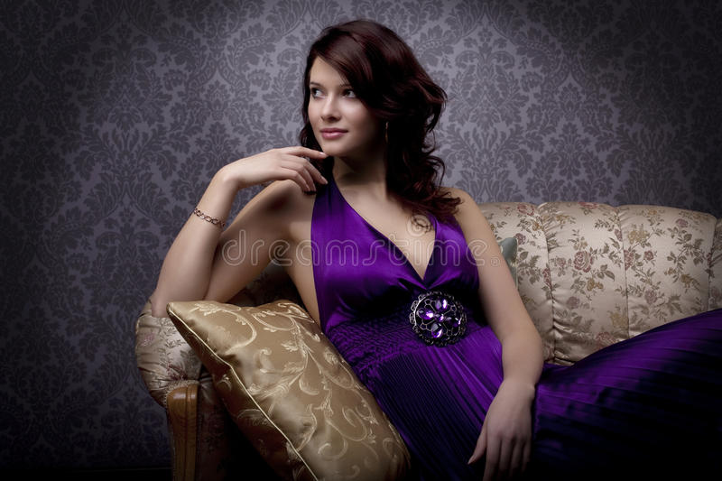 Glamorous girl on the couch. Images of beautiful glamorous girl on the couch royalty free stock photo