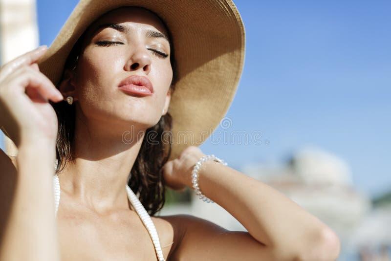 Glamorous girl posin in sun. And sunbathing stock images