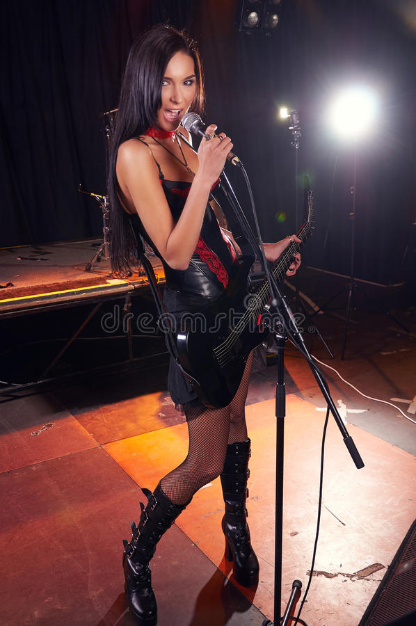 Glamorous girl singing on the stage stock photo