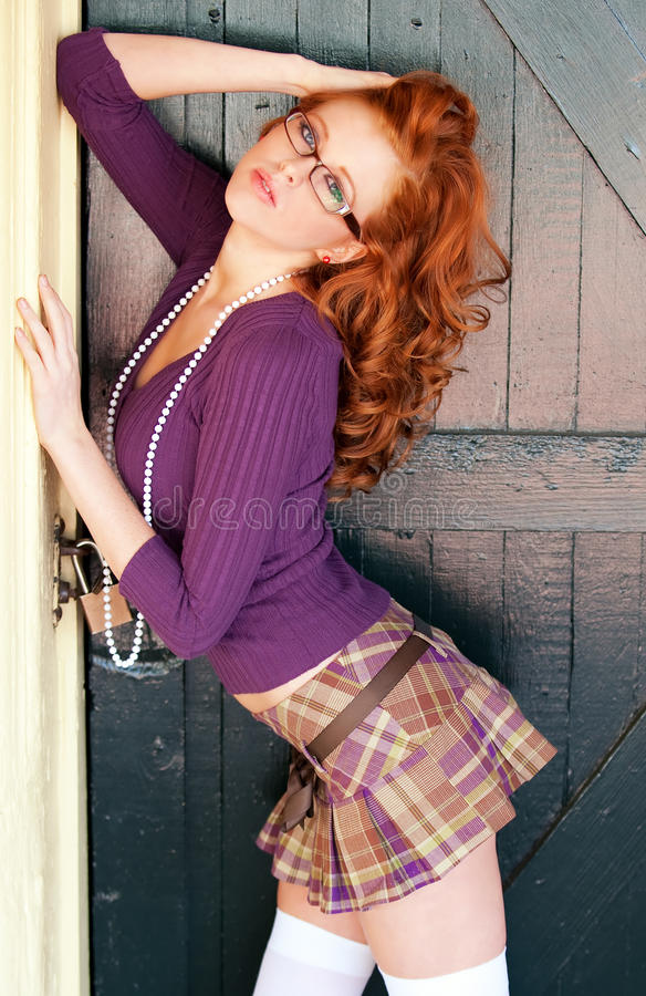 Download Glamorous red headed woman stock image. Image of tartan - 12528761