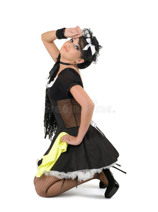 Glamorous french maid with duster stock images