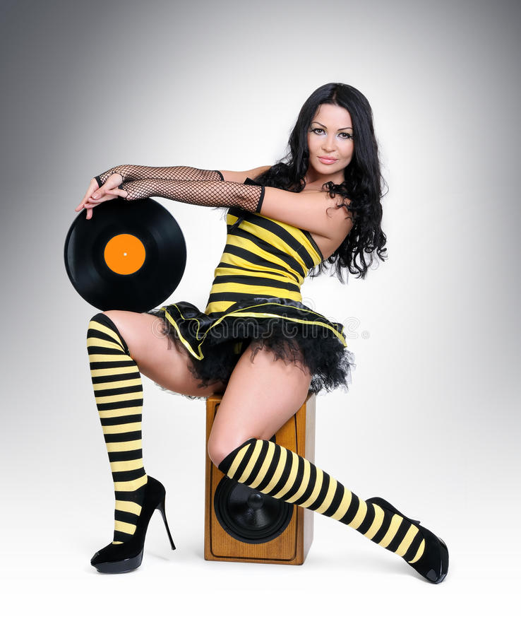 Download Glamorous Young Girl With Vinyl On Speaker Stock Photo - Image: 25398476